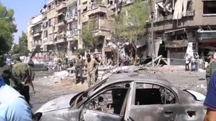 شاهد الدمار الذي خلفه تفجير سيارة مفخخة قرب ساحة التحرير في دمشق