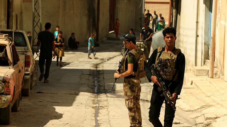 اشتباكات بين فصائل مساندة للقوات العراقية