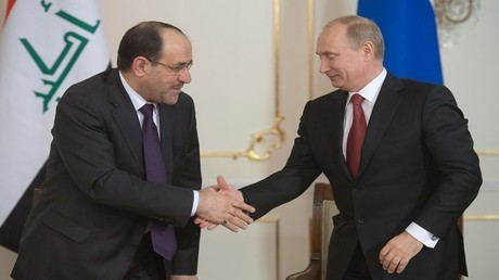 صورة من الأرشيف للرئيس فلاديمير بوتين ونائب الرئيس العراقي نوري المالكي