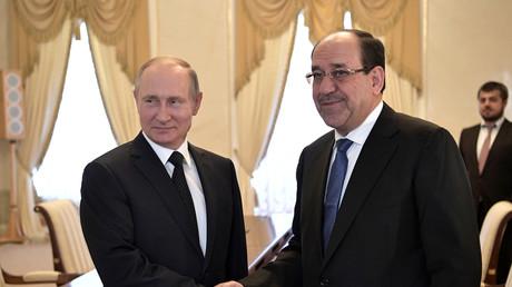 الرئيس الروسي فلاديمير بوتين ونائب الرئيس العراقي نوري المالكي