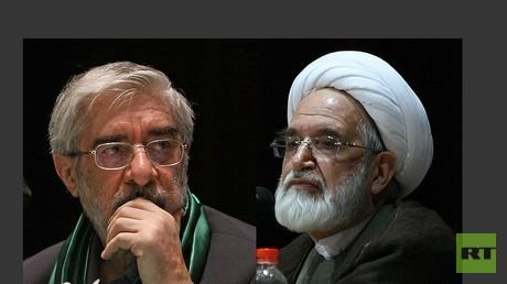مهدي كروبي (يمين) ومير حسين موسوي (يسار)
