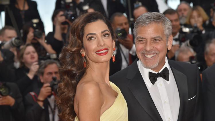 الزوجان كلوني يتبرعان بمليون دولار لمكافحة