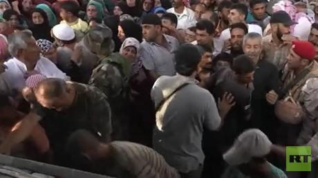توزيع مساعدات إنسانية روسية شمال حمص