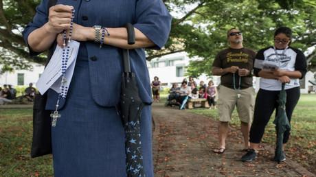 سكان من جزيرة غوام الأمريكية يصلّون من أجل السلام
