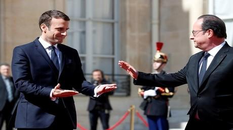 الرئيسين الفرنسيين السابق فرنسوا هولاند والحالي إيمانويل ماكرون