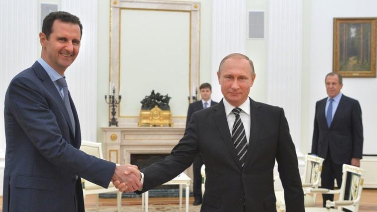 بوتين هنأ الأسد بفك الحصار عن دير الزور