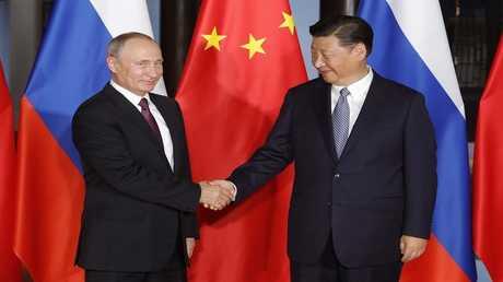 الرئيس الروسي فلاديمير بوتين، والرئيس الصيني شي جين بينغ