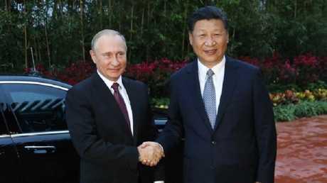 الرئيس الروسي فلاديمير بوتين ونظيره الصيني