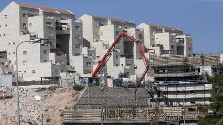 بناء منازل جديدة في مستوطنة كريات أربع شرقي مدينة الخليل بالضفة الغربية، 24 أغسطس 2017