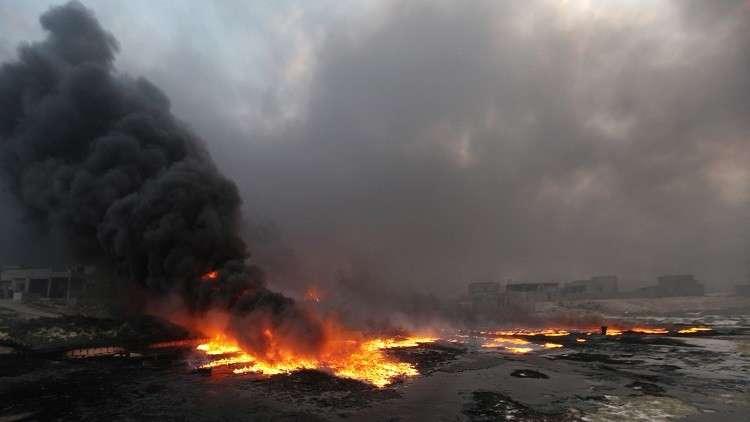 داعش يحرق آبار النفط في الحويجة شمالي العراق