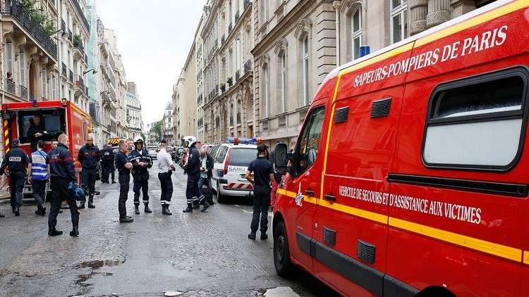 رجل ينتحر من نافذة فندق في باريس حاملا طفليه