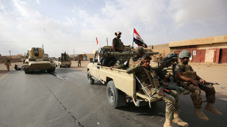 العبادي يعلن تحرير قضاء القائم على الحدود مع سوريا بالكامل