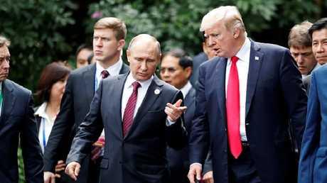 الرئيسان الروسي فلاديمير بوتين والأمريكي دونالد ترامب في قمة آبيك