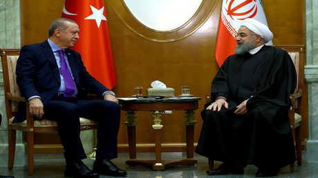 الرئيس التركي رجب طيب أردوغان ونظيره الإيراني حسن روحاني - أرشيف