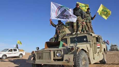 القوات الأمنية العراقية والحشد الشعبي المساند لها - أرشيف