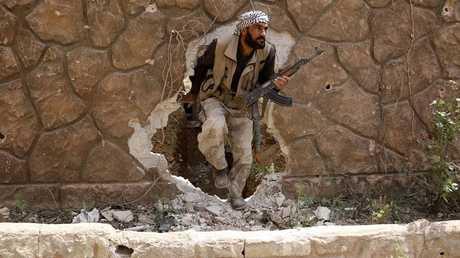 """أحد عناصر """"جيش الإسلام"""" في غوطة دمشق الشرقية - صورة أرشيفية"""