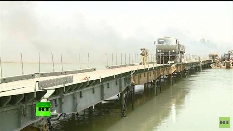 شبهات بتورط  الولايات المتحدة في تدمير الجسر الروسي على نهر الفرات بسوريا!