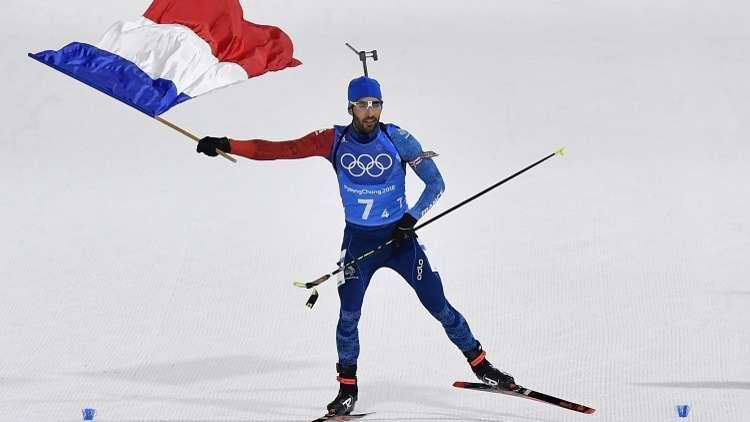 فوركاد مع رفع العلم الروسي في حفل ختام أولمبياد 2018
