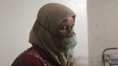 مواطنة سورية أصيبت بهجوم كيميائي - صورة أرشيفية