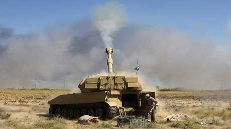 """أرشيف - دبابة عراقية تستهدف مواقع لتنظيم """"داعش"""" الإرهابي"""