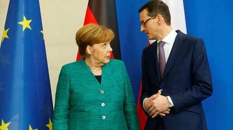 المستشارة الألمانية أنغيلا ميركل ورئيس الوزراء البولندي، ماتيوس مورافيتسكي
