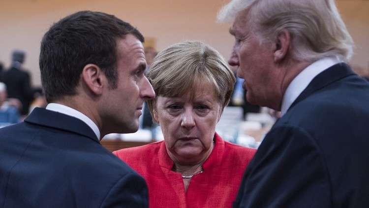 ترامب يبحث مع ميركل وماكرون