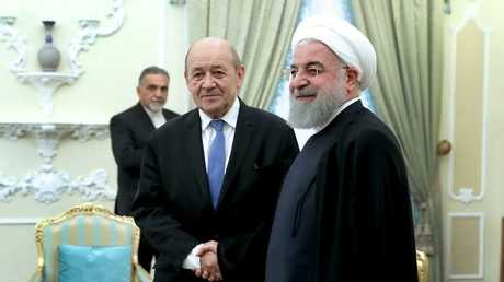 الرئيس الإيراني حسن روحاني ووزير الخارجية الفرنسية جان أيف  لودريان