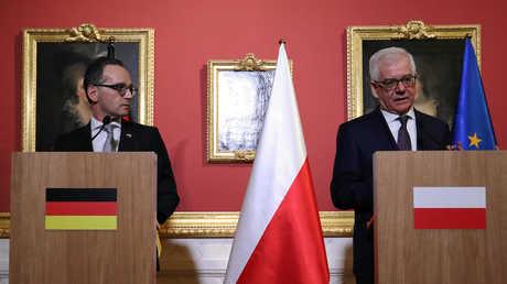 وزير الخارجية الألماني هايكو ماس مع وزير الخارجية البولندي ياتسيك تشابوتوفيتش