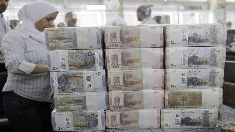 الليرة السورية تزاحم الدولار في السوق السوداء