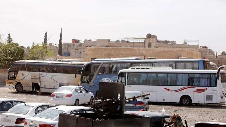 مغادرة 19 حافلة تقل المسلحين من دوما