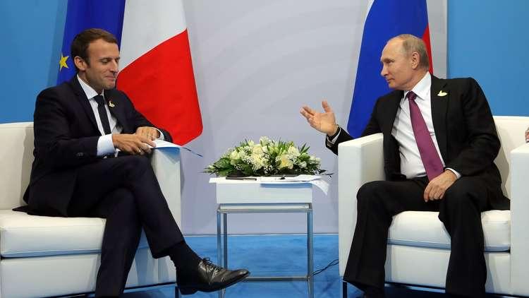 الرئيس الروسي فلاديمير بوتين والرئيس الفرنسي إيمانويل ماكرون، هامبورغ، ألمانيا، 8 يوليو 2017