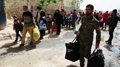 خروج مدنيين من منطقة الغوطة الشرقية