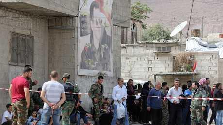 إخراج المسلحين والمدنيين من مدينة دوما