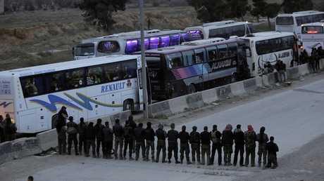 عناصر مسلحة بحرستا بعد خروجهم من الغوطة الشرقية - أرشيف -