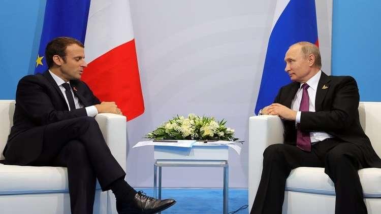 بوتين يبحث مسألتي إيران وسوريا مع ماكرون على هامش منتدى بطرسبورغ