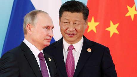 """الرئيسان الصيني، شي جين بينغ، والروسي، فلاديمير بوتين، خلال أعمال قمة مجموعة """"بريكس"""" في الصين يوم 4 سبتمبر 2017"""