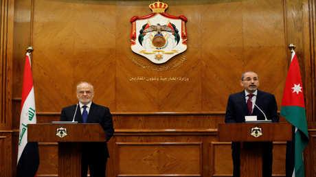 وزير الخارجية الأردني أيمن الصفدي ونظيره العراقي إبراهيم الجعفري