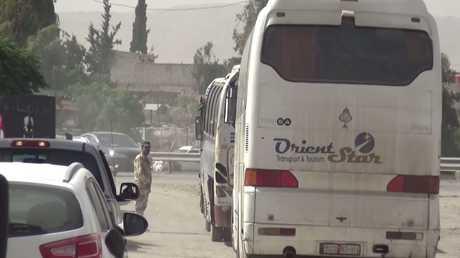 تواصل خروج المسلحين وعائلاتهم من بلدات يلدا وببيلا وبيت سحم جنوب دمشق