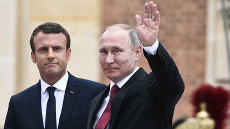 الرئيسان الروسي فلاديمير بوتين والفرنسي إيمانويل ماركون