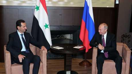 الرئيس الروسي فلاديمير بوتين خلال لقائه الرئيس السوري بشار الاسد في سوتشي يوم 17 مايو 2018