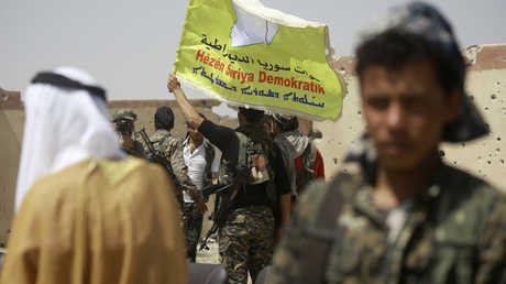 """عناصر """"قوات سوريا الديمقراطية"""" في الرقة"""