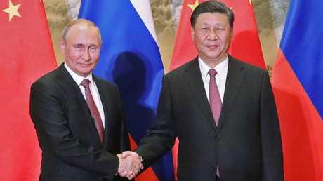 الرئيس الروسي، فلاديمير بوتين، ونظيره الصيني، شي جينغ بين، خلال لقائهما في بكين يوم 8 يونيو