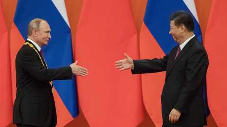 الرئيسان الروسي فلاديمير بوتين والصيني شي جينغ بين