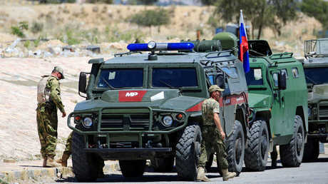 سيارات للشرطة العسكرية الروسية في الغوطة الشرقية (أرشيف)