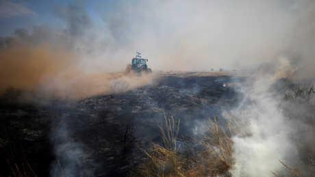 حريق مندلع بواسطة طائرة ورقية حارقة من قطاع غزة