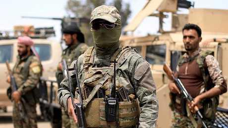 """عناصر من """"قوات سوريا الديمقراطية"""" (قسد)"""