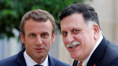 الرئيس الفرنسي إيمانويل ماكرون، ورئيس حكومة الوفاق الوطني الليبية فايز السراج - أرشيف