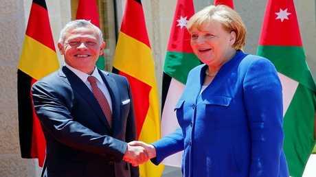 العاهل الأردني الملك عبدالله الثاني والمستشارة الألمانية أنغيلا ميركل