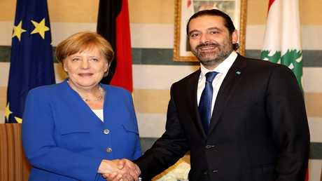 المستشارة الألمانية أنغيلا ميركل ورئيس الوزراء اللبناني سعد الحريري