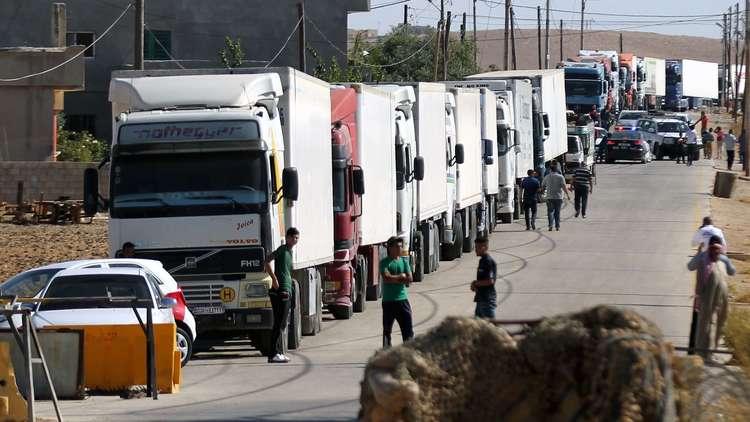 ممثلو الهلال الأحمر السوري والأمم المتحدة يوزعون المساعدات الفرنسية في الغوطة الشرقية